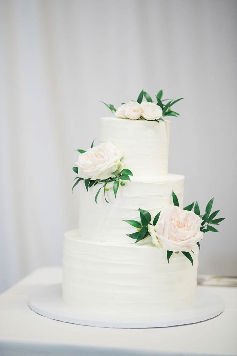 White Cake with Accent Flowers on Each Tier
