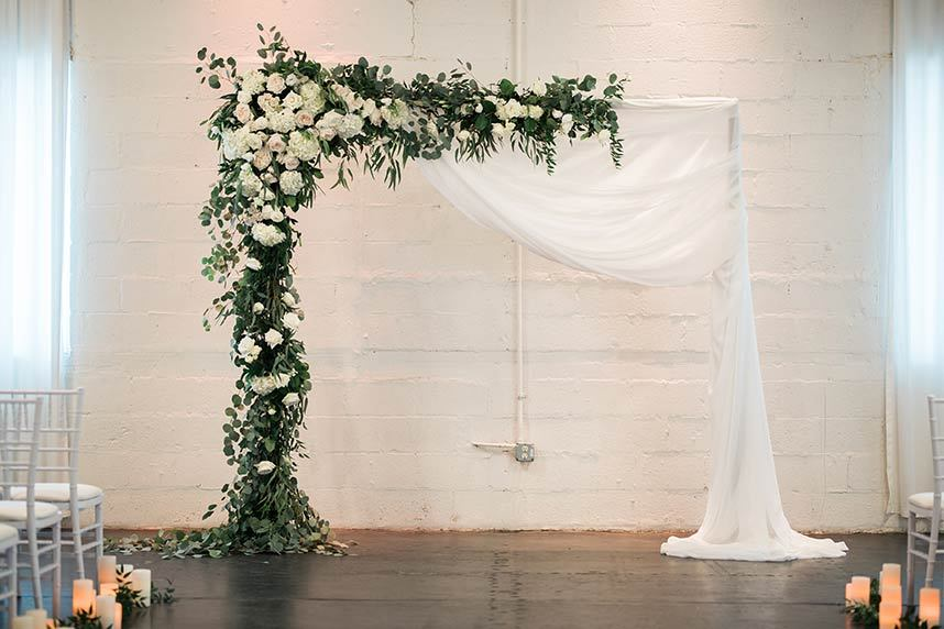 Ceremony Arch with Flowers and Draping