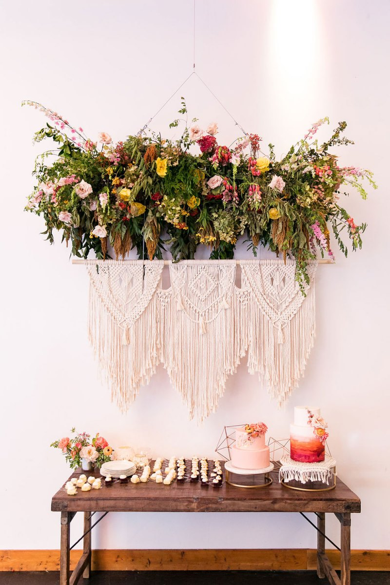Floral Installment Hanging Over the Macramé Tapestry