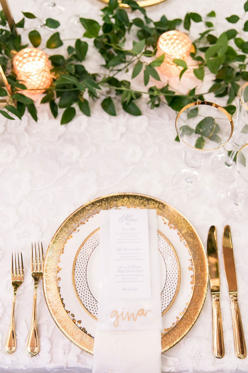 Gold Rimmed Glassware and Silverware on White Detailed Linen