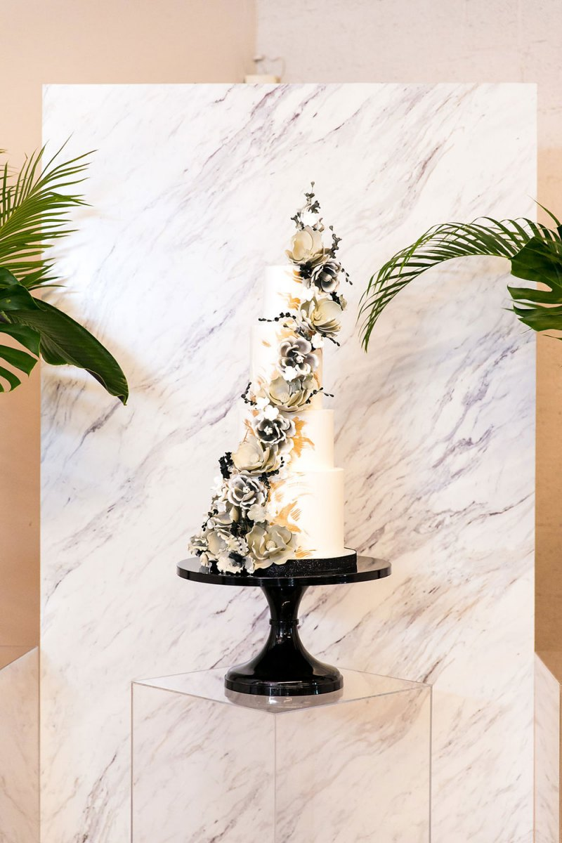 Modern Black and White Flowers on Multi-Layered Cake